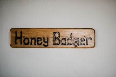 The Village Lodge Honeybadger Room name